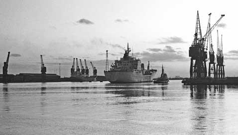 Ship moored in Newport dock beside cranes
